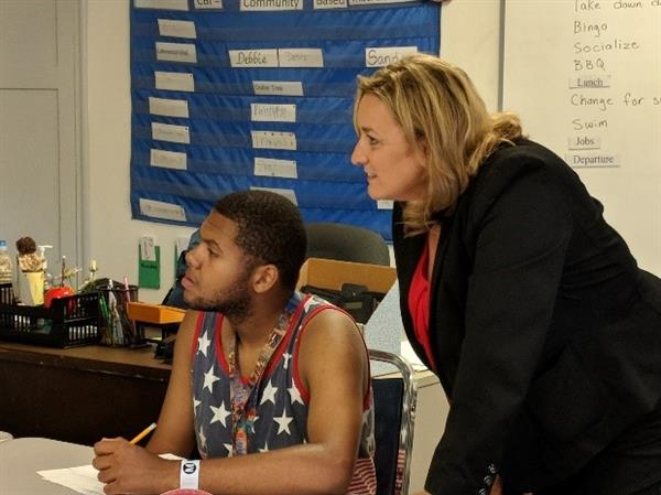Superintendent McSparren working with a high school student.