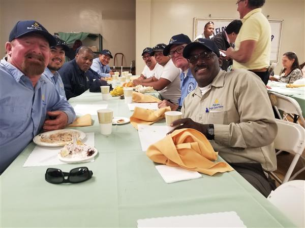 BUSD's maintenance and Operations staff enjoying a turkey meal.