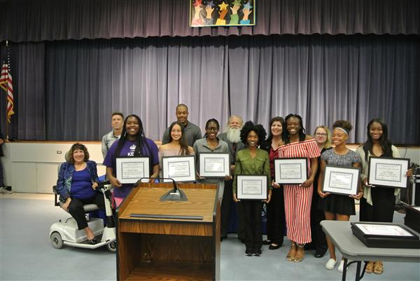 Girls' Track & Field Team receiving recognition at the May 23, 2018 School Board Meeting.