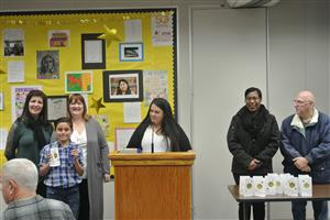 School Board members and student celebrating Reflections Contest win.